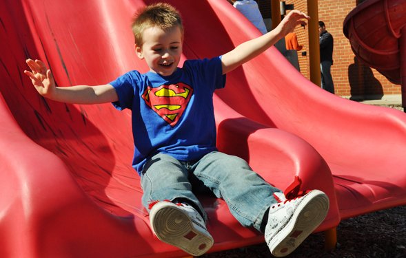 autism boy on slide